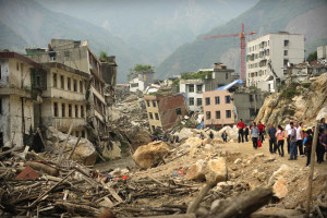 People walk through the devastated town of Beichuan in China's earthquake ravaged Sichuan province on May 10, 2009.  A year after the Sichuan earthquake devastated huge parts of southwest China, the grief and desperation of the tragedy still haunts the survivors of the magnitude 8.0 tremor. AFP PHOTO/Peter PARKS (Photo credit should read PETER PARKS/AFP/Getty Images)