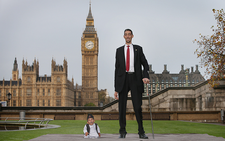 LONDON, ENGLAND - NOVEMBER 13:  The shortest man ever, Chandra Bahadur Dangi meets the world's tallest man, Sultan Kosen for the very first time on November 13, 2014 in London, England. Chandra from Nepal measuring 54.6 cm (21.5 inches) posed for photographers with Sultan from Turkey who is 251 cm (8 ft 3 inches). Today is the 10th annual Guinness World Records Day during which thousands of people are expected to come together to celebrate the international day of record-breaking!  (Photo by Peter Macdiarmid/Getty Images)